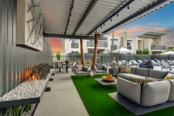 outdoor-living-room-with-firepit-angled-dusk
